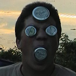Man with McChrystal's Snuff tins in his eyes, mouth and on his forehead